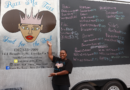 Latoya Fields standing in front of their soul food business Razz Ma Tazz